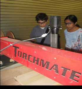student-manufacturers-with-cnc-torchmate-wood-router-cnc