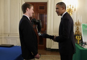 easton and president obama shaking hands with robotic arm